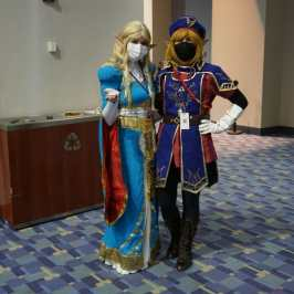 Photo of cosplayers at Otakon 2021 dressed as Link and Zelda from The Legend of Zelda: Breath of the Wild