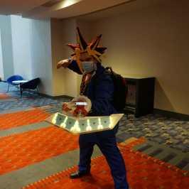 Photo of a cosplayer at Otakon 2021 dressed as Yugi from Yu-Gi-Oh!