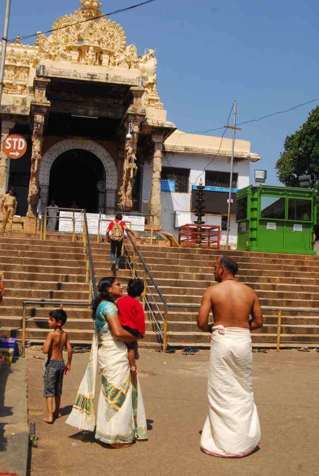 A couple getting ready to enter the temple premises