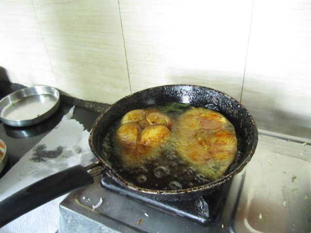 Seer fish being fried by our chef