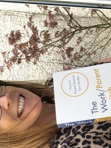 Anita Cleare, parenting expert, holding a copy of her book The Work/Parent Switch