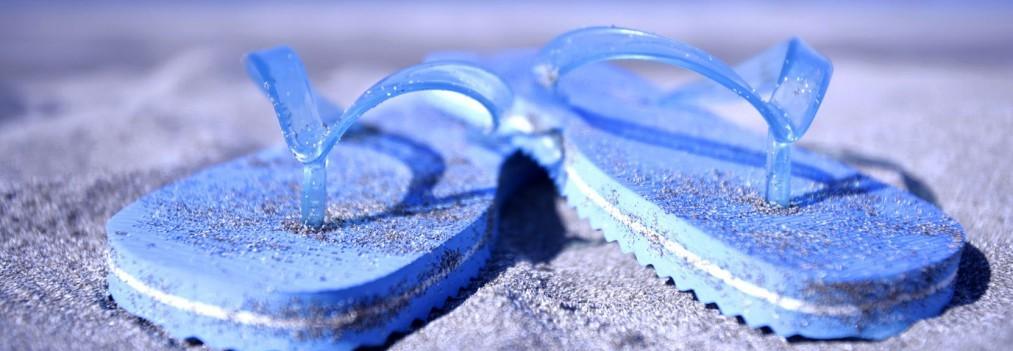 Blue slippers on beach