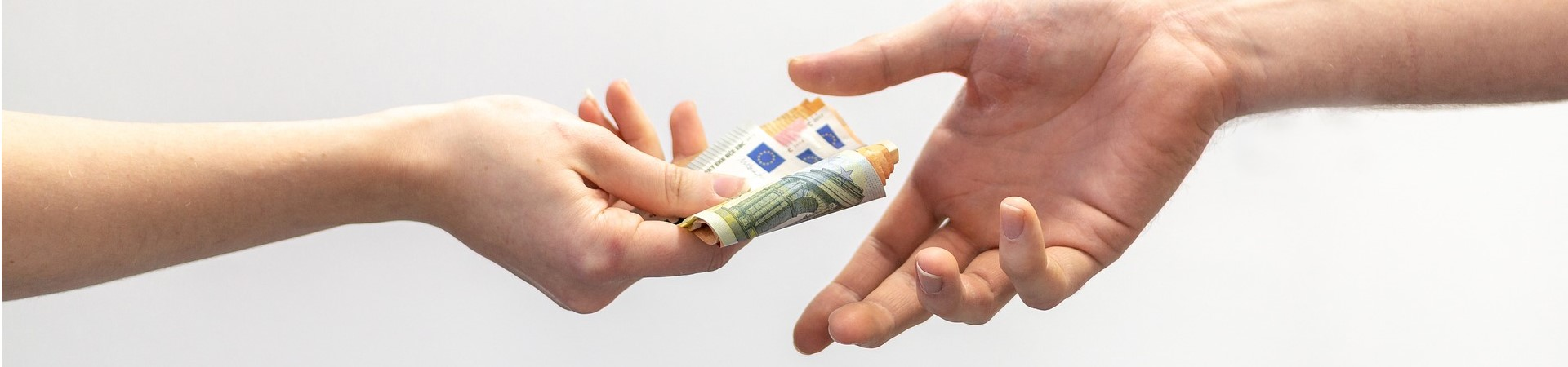 Female hand giving money to male hand