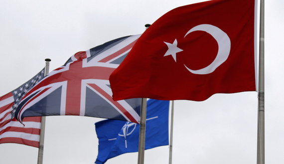 A Turkish flag (R) flies among others flags of NATO members during the North Atlantic Council (NAC) at the Alliance headquarters in Brussels, Belgium, July 28, 2015. REUTERS/Francois Lenoir/File Photo - RTSRWLT