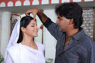 Pawan Singh with Smriti Sinha