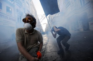 Protestors clash with Turkish riot policemen during a protest ag