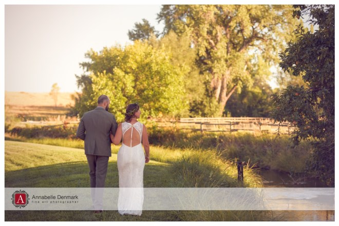 The groom and bride walking into the sunset