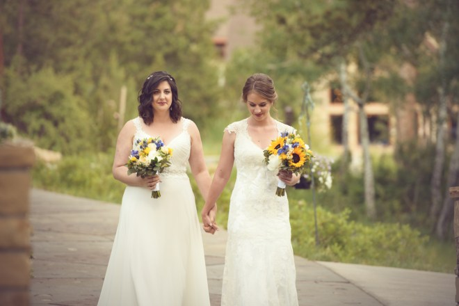 brides walking toward ceremony site Della Terra