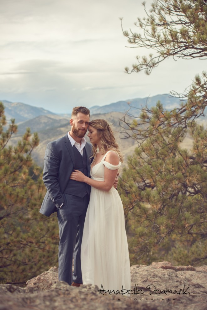 engagement pictures in the woods in the mountain, romantic, white dress and  dark blue suit