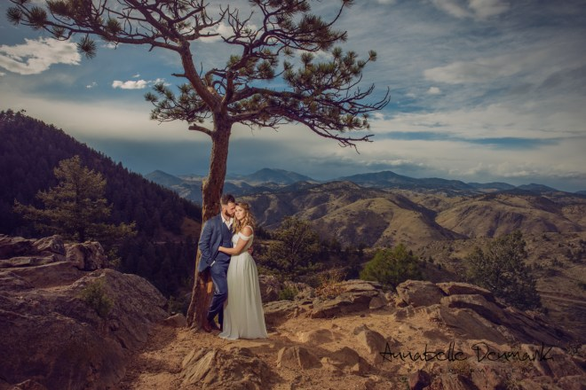 epic image engagement pictures in the woods in the mountain, romantic, white dress and  dark blue suit