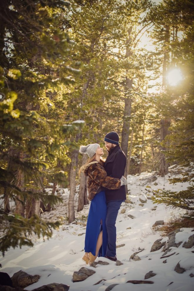 Couple kissing in the Snow and forest