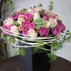 Enviamos flores a domicilio en el DF como este arreglo floral de rosas rosas.