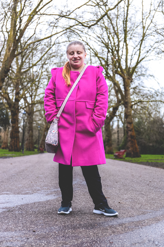 the girl in the pink coat