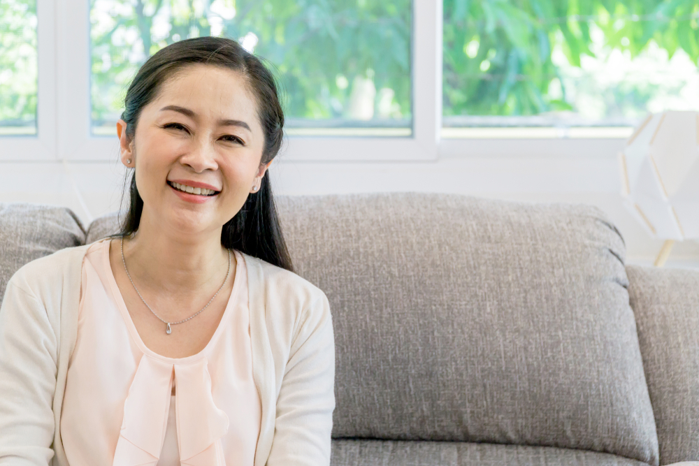 middle aged asian woman on couch