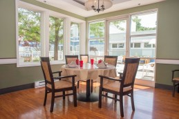 The Cattail Dining room is bright and sunny. Bright red cups are easy for those with physical and cognitive impairments to recognize and hold.