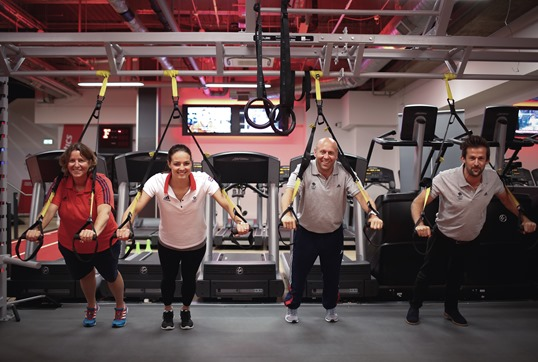 LONDON, ENGLAND - AUGUST 04:  Members of the EIS staff take Fitness First customers through their paces at the announcement to launch Fitness First as the official new fitness partner of Team GB, at Fitness First Bishopsgate, on August 4, 2015 in London, England.