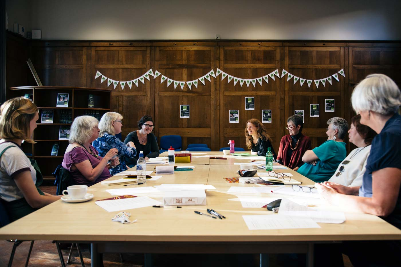 Anna Woodford leads a group of people at a poetry workshop