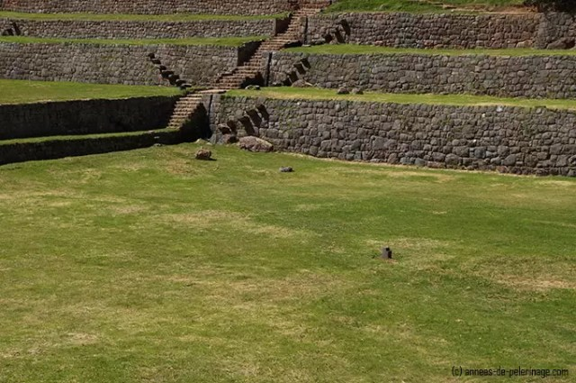 A ritual marking stone in the middle of the biggest inca terrace in tipon