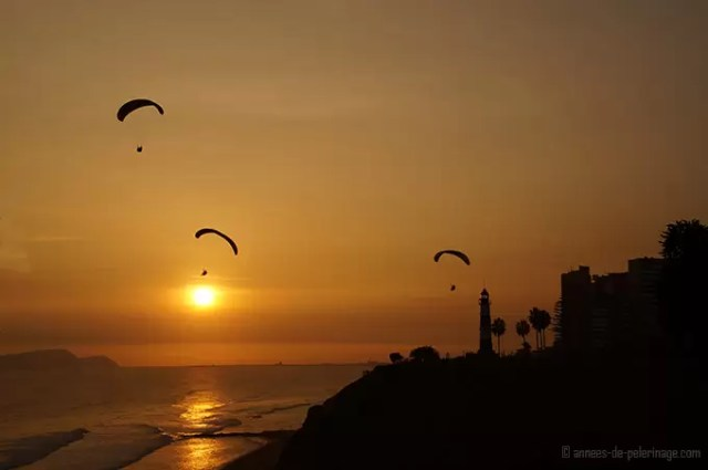 The miraflores district in lima at sunset with paragliders in the air. number 1 destination on my peru itinerary