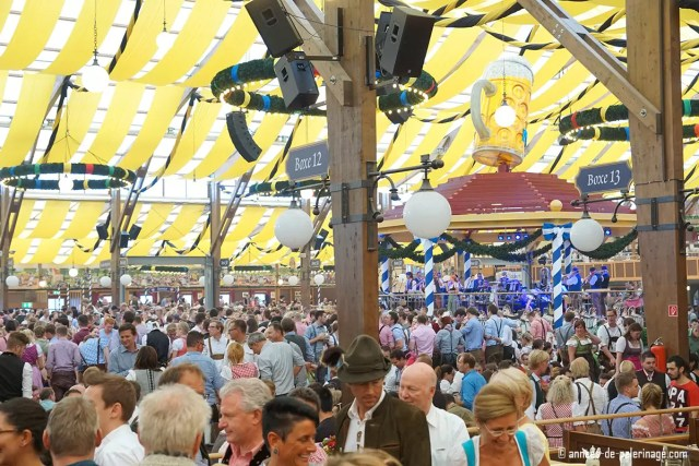 Inside a beer tent at Oktoberfest with quite a crowd