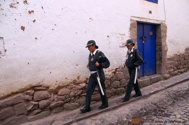 Two police women in Barrio de San Blas, Cusco, Peru