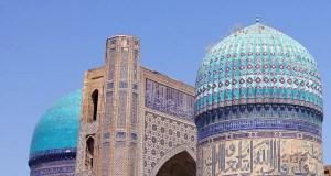 blue tiled domes of the Bibi-Khanym Mosque in Samarkand, Uzbekistan
