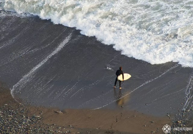 A surfer in Lima Peru - one of the many things to do in Lima