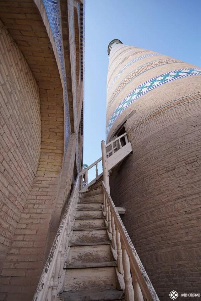 Climbing the Minaret Islam-Khodja complex in Khiva, Uzbekistan