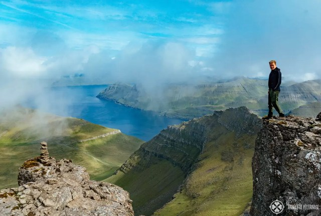 Me standing at the top of the Slættaratindur - one of the best hikes in the Faroe Islands