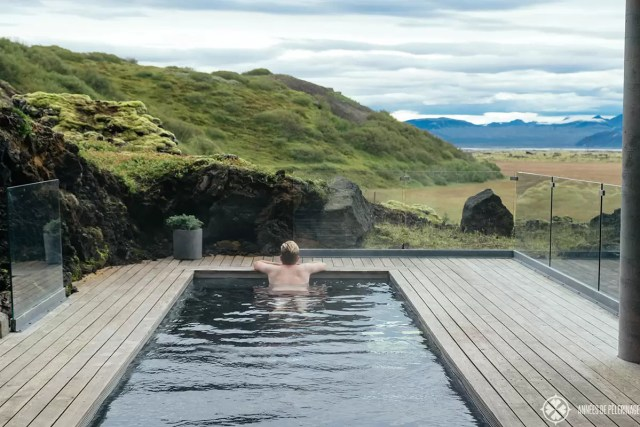 Me enjoying the view from the pool of the Ion Adventure Hotel in Iceland