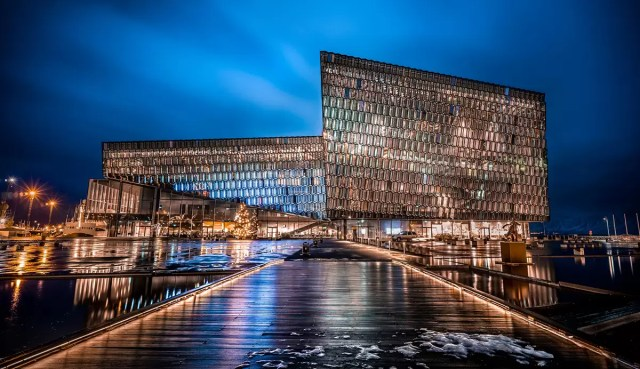 harpa concert hall at night, right near the harbor of Reykjavik