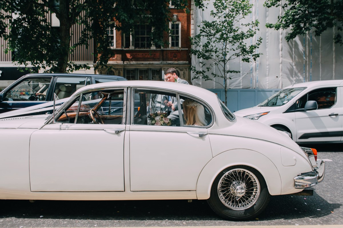 vintage wedding car at chelsea town hall