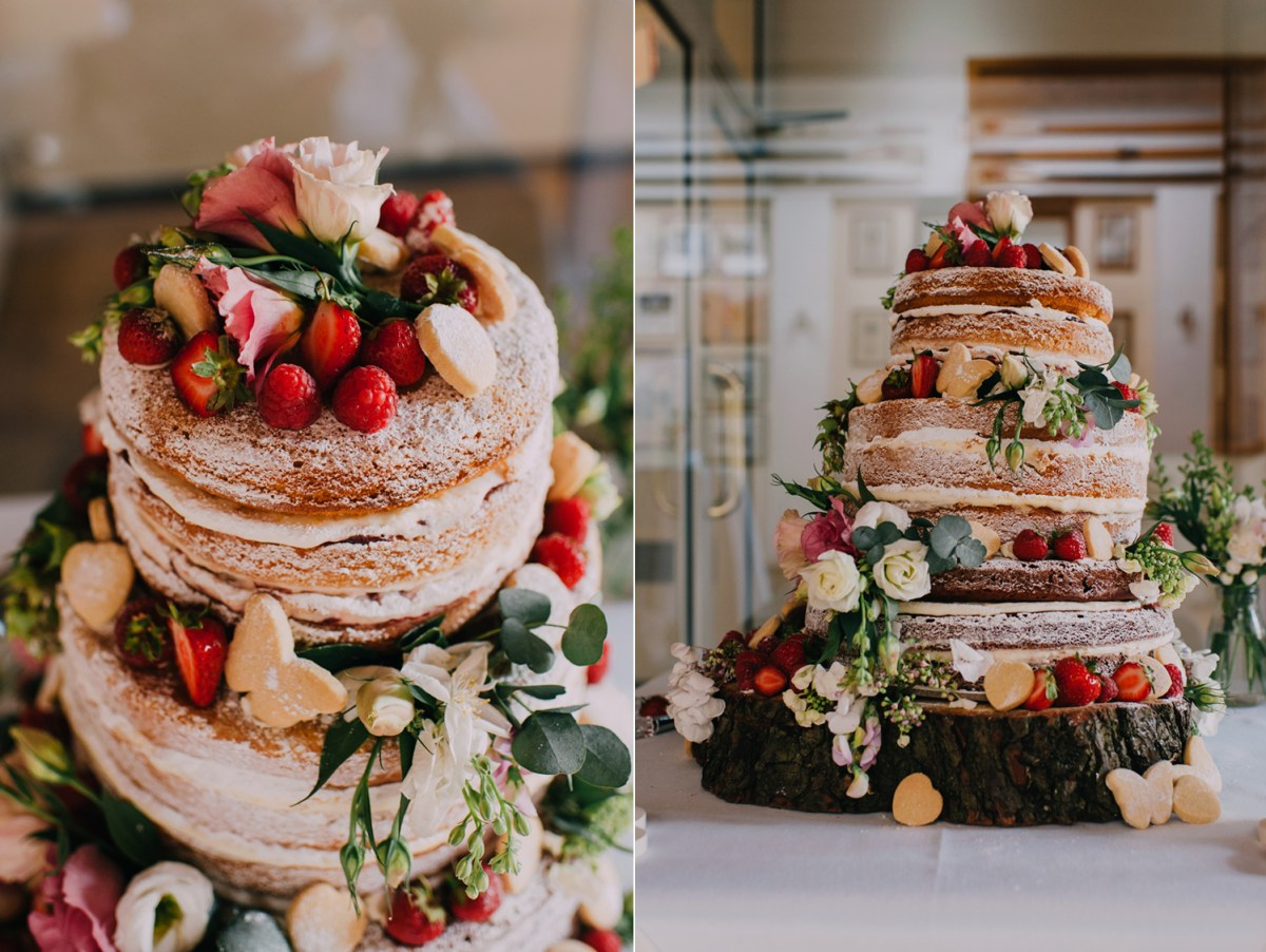 naked wedding cake with real flowers and berries