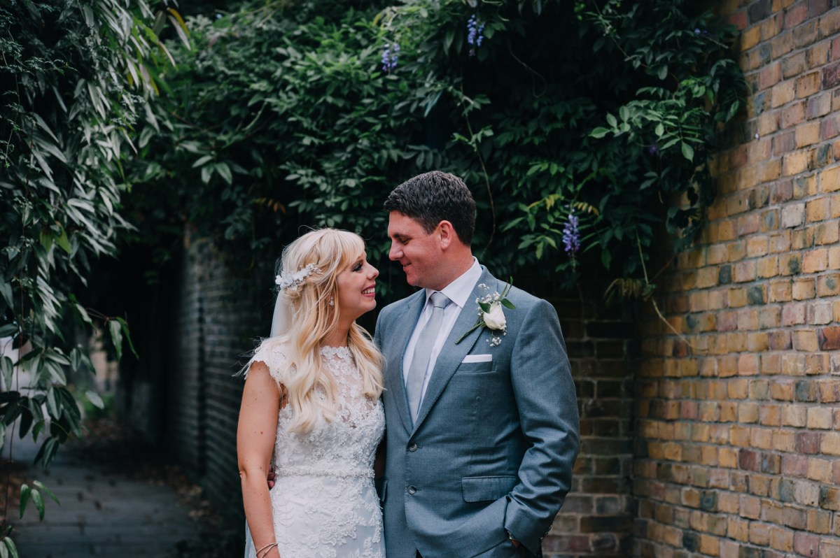 bride and groom portrait at dusk with wisteria