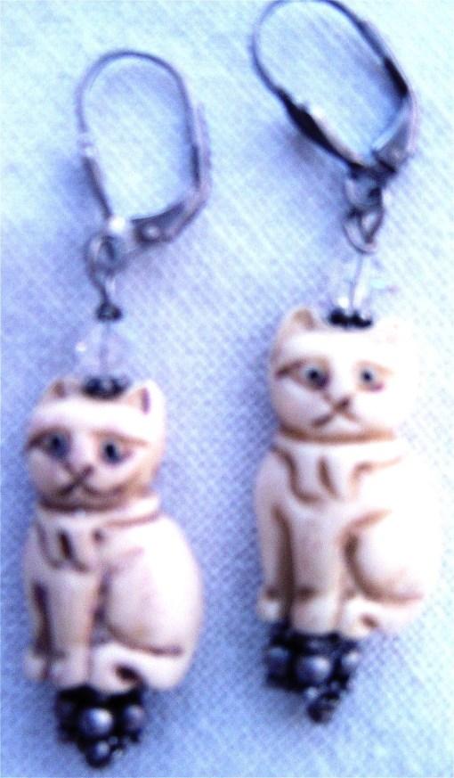 Bone cat earrings