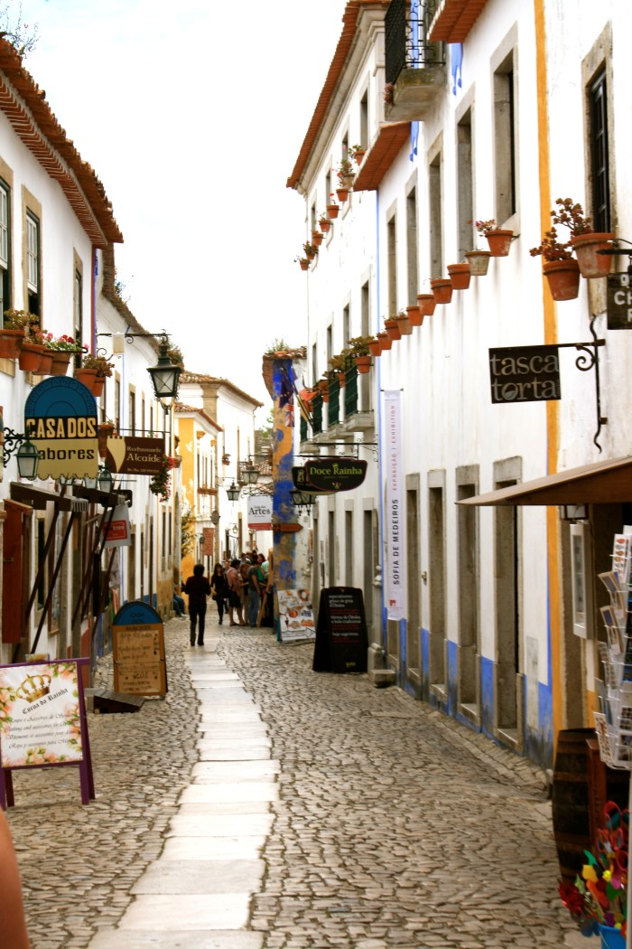 Main Street of Obidos in Portugal, with cafes, shops and hotels