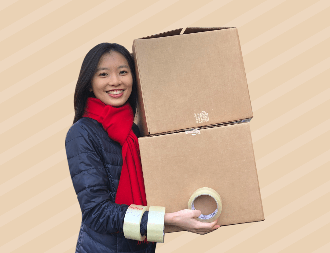 Annie Yang Holding Two Cardboard Boxes