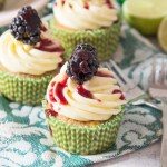 Soft, blackberry filled cupcakes with lime butter cream frosting and blackberry coulis. An explosion of flavour in every bite!