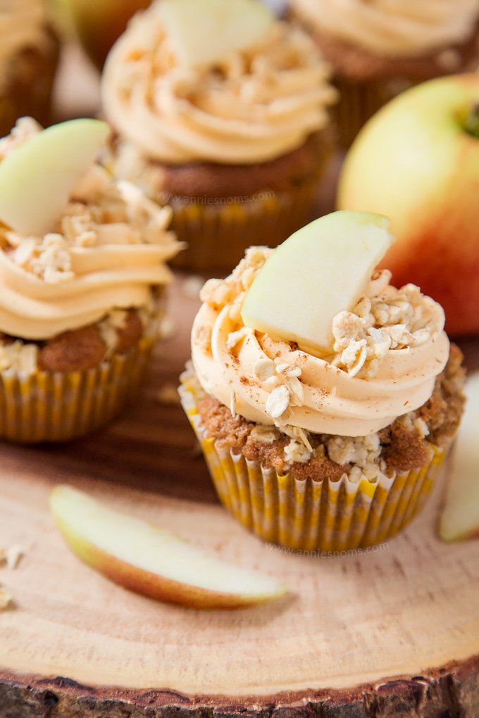 My Apple Crumble Cupcakes are soft, apple filled and topped with deliciously smooth custard frosting and crunchy crumbles. The perfect way to enjoy a classic British dessert!