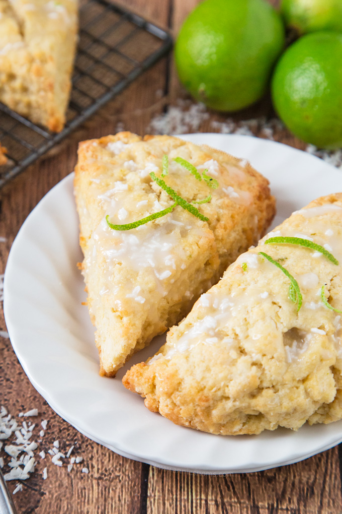 These Lime and Coconut Scones bring a taste of the tropics to a dull winter's day! Served with a coconut glaze, these are a perfect way to start the day!