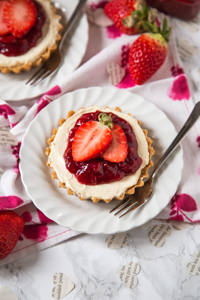 Delightfully creamy and sweet no bake Strawberry Cheesecakes individually portioned and perfect for a Valentine's Day dessert!