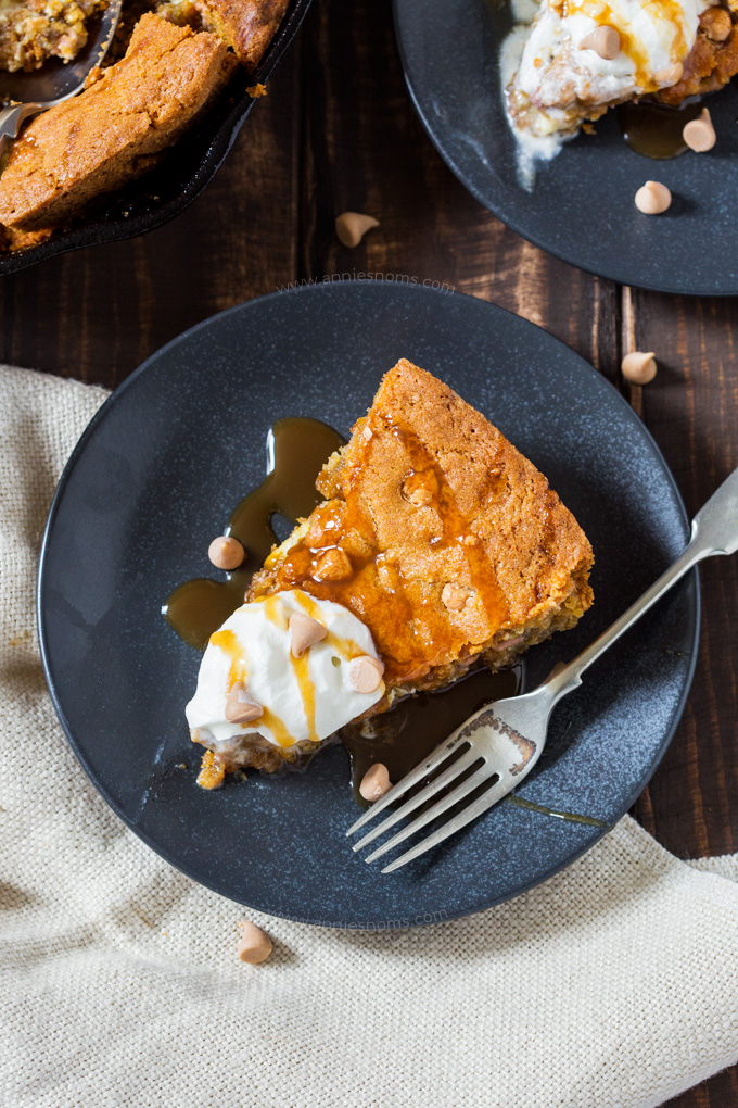 Soft and chewy cookie dough filled with butterscotch and white chocolate chips. Baked until golden and served with ice cream, this skillet cookie is almost too good to share!