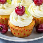 These Cherry and Lime Cupcakes are filled with homemade jam and lime zest. Topped with light, fluffy frosting, they are the perfect balance of tart and sweet.