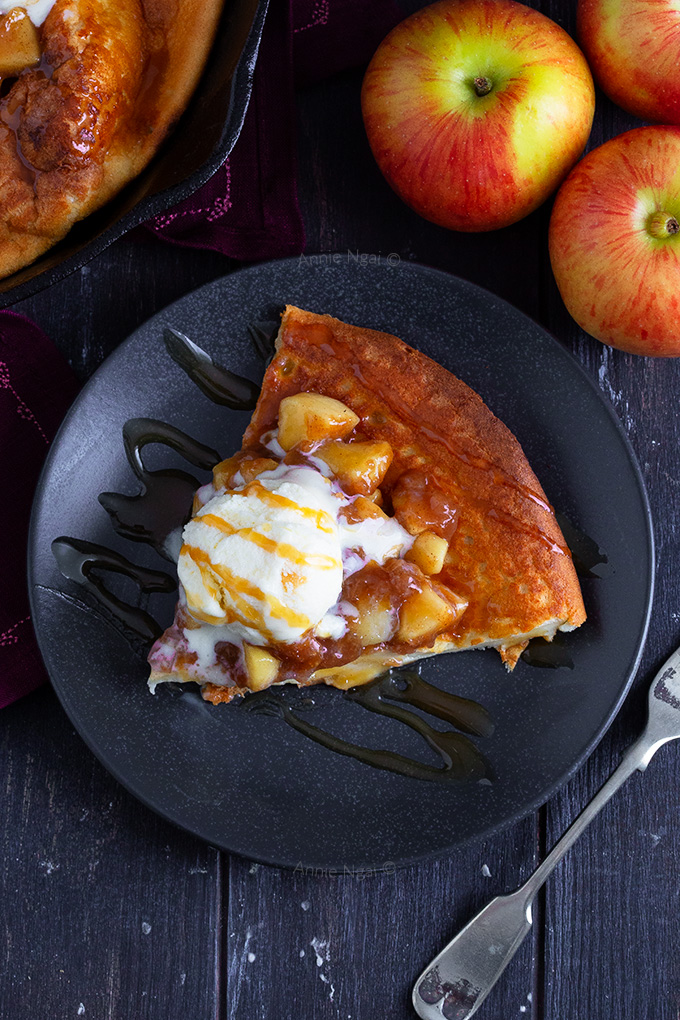 This Apple Pie Dutch Baby Pancake is easy to make and feeds a crowd! It's a hybrid between breakfast and dessert and packed full of flavour!