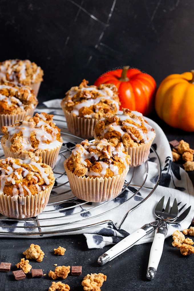 These Pumpkin Chocolate Chip Muffins are topped with a crunchy oat mixture and baked to create a soft, spiced muffin peppered with chocolate with a crunchy streusel top!