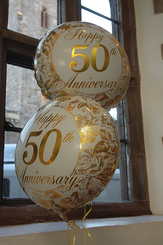 rent tablecloths and chair covers queen anne dining room chairs golden 50th anniversary party ideas for a special couple