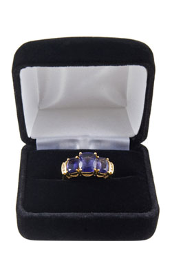 Iolite ring in a blue jewelry cushioned case indicating the type of gifts that can be purchased for the 21st wedding anniversary