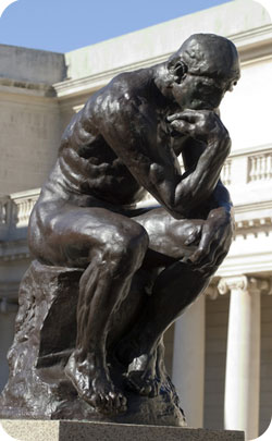 The thinker sculpture used to represent the 27th anniversary symbol