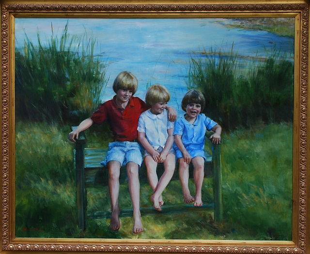 large portrait of three little boys on a bench