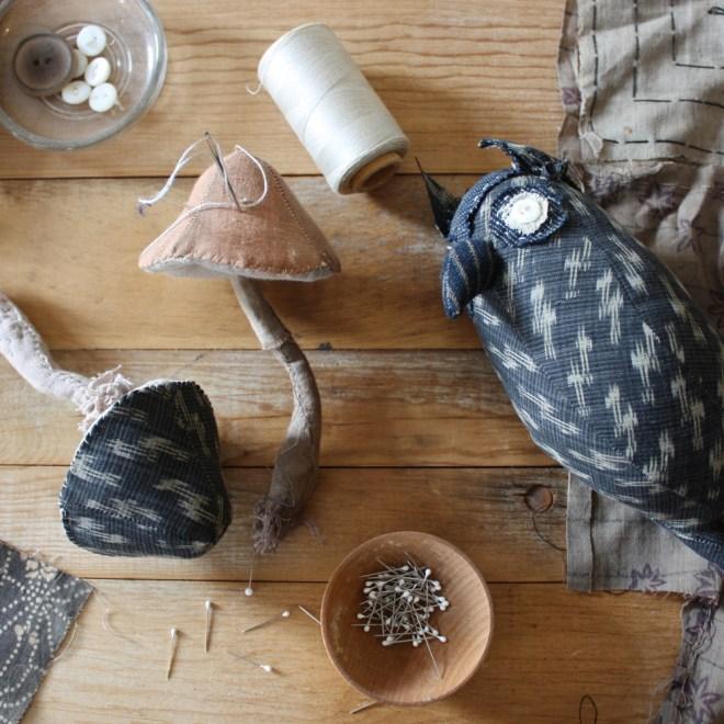 owl and mushrooms on my worktable
